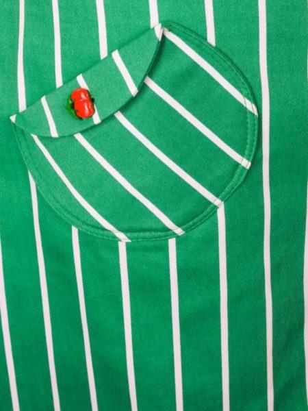 Lommedetaljer på grøn stribet nederdel