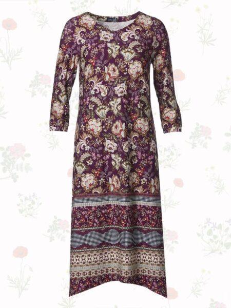 lang lilla kjole med dryp effekt i bunden