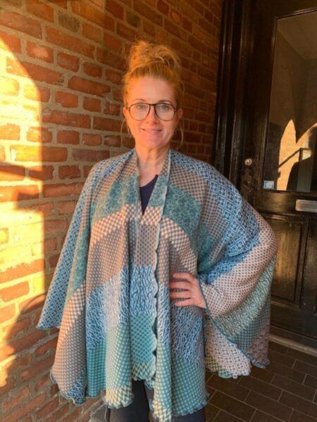 Kappe i merino uld i lyse grå/blå farver
